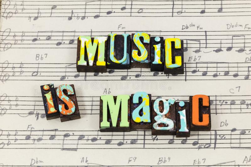 Music magic magical musical song sheet alive happy enjoy letterpress type. Music magic magical musical song sheet alive happy enjoy typography font live love royalty free stock photo