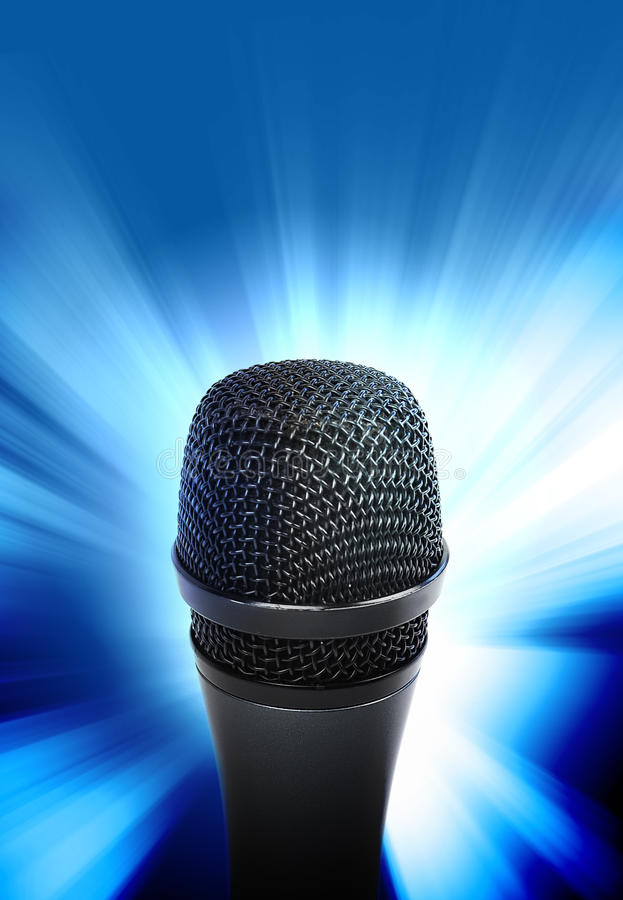 Music Microphone Glowing. An audio microphone is glowing on a blue background. Use it for a music or entertainment concept stock photos
