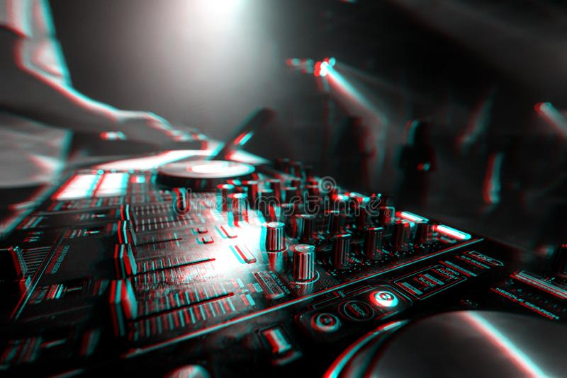 Music mixer DJ controller Board for professional mixing of electronic music. In a nightclub at a party. Black and white photo with glitch effect and small grain royalty free stock photo
