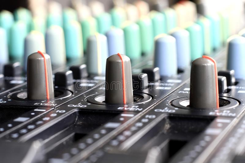Music mixer. Image of a Music mixer on a table royalty free stock photo