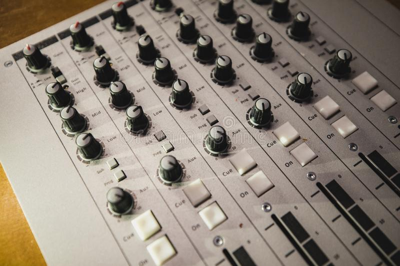 Music Mixing Equipment. A directly above shot of a sound mixer on a desk in a radio station studio stock photos