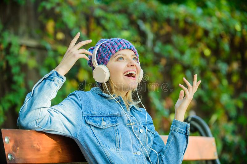 Music is so much fun. modern technology instead of reading. relax in park. hipster girl with mp3 player. listening music royalty free stock images