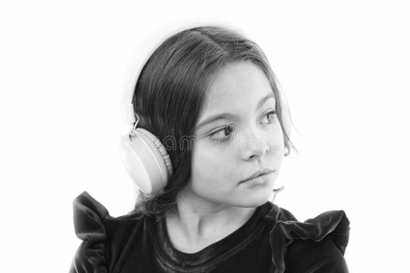 Music is so much fun. small girl in red dress. childhood and happiness. small child in headphones. music. listening. Ebook. audio education. kid fashion and stock photography