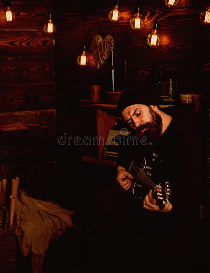 Music is my escape. Hipster musician. Rock guitarist playing music. Bearded man play the guitar. Rock style man. Rock stock images