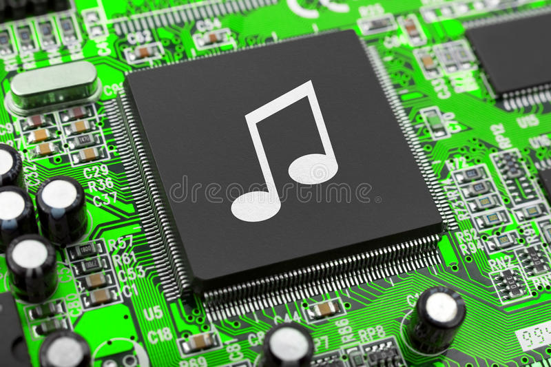Music note on computer chip stock photos