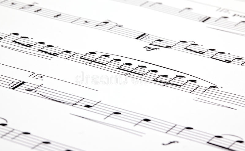 Music notes. On white paper with shallow DoF