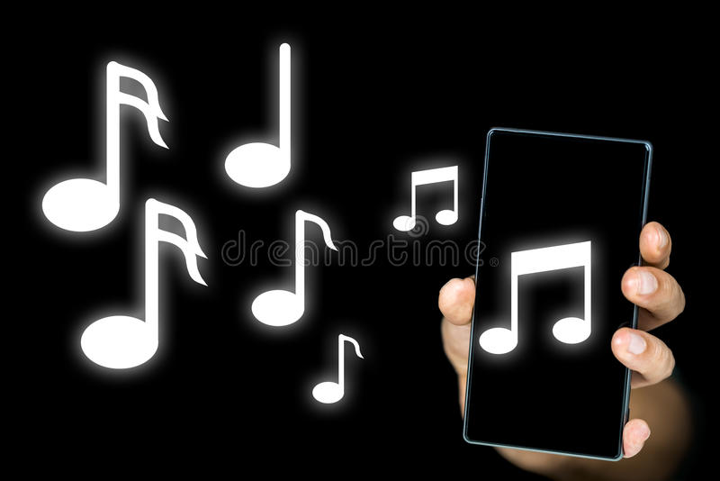Music notes issuing from an mp3 player or mobile royalty free stock photo