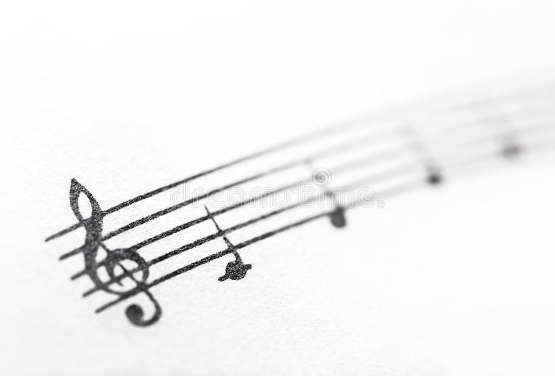 Music notes on paper royalty free stock images