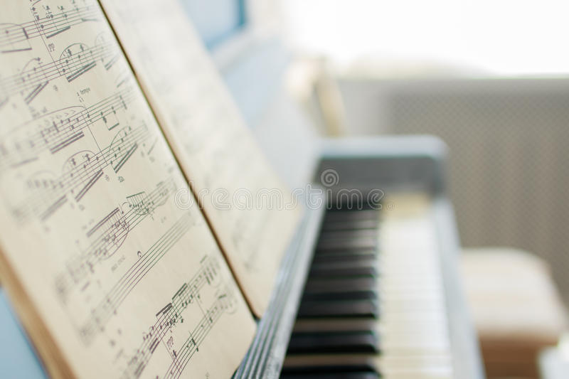 The music notes on the piano stock photography