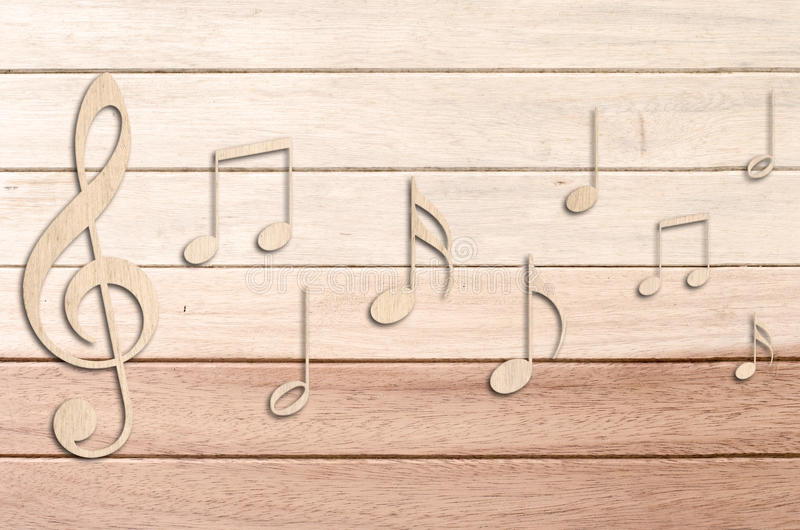 Music notes. On wood background stock photography