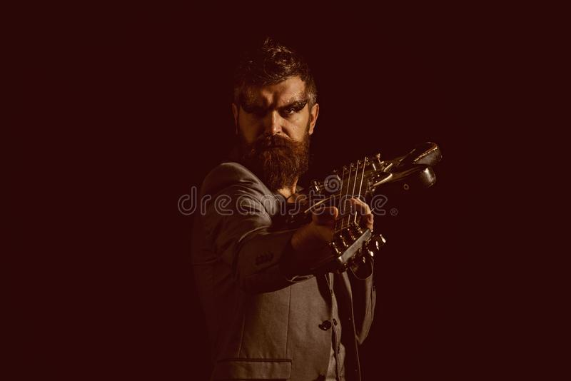 Music party and entertainment. Man go to music party. Bearded man with guitar ready to play at music party. Guitarist. With musical instrument at music party stock image