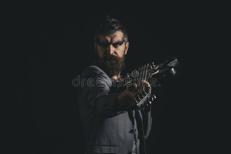 Music party and entertainment. Man go to music party. Bearded man with guitar ready to play at music party. Guitarist. With musical instrument at music party royalty free stock image