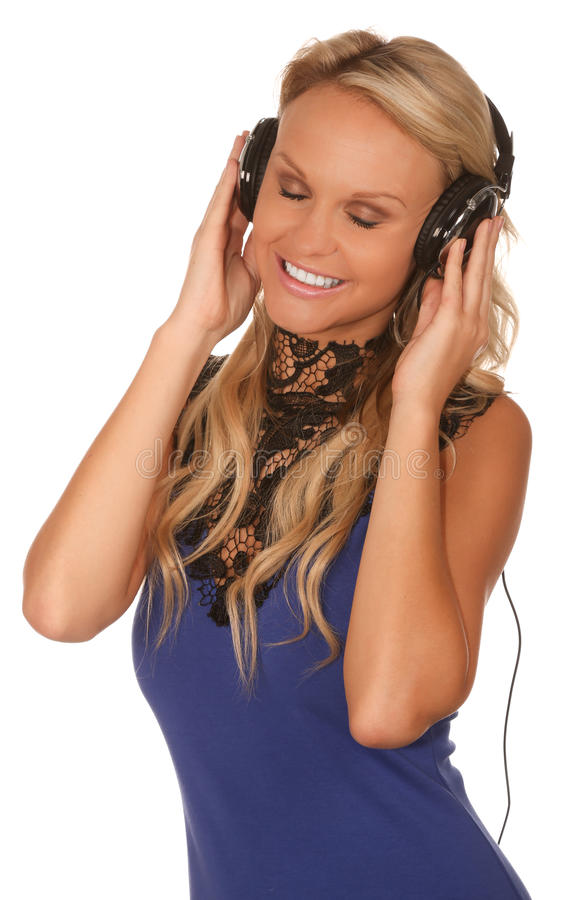 Music Party Time Girl. Lovely blonde party girl with earphones listening to musice stock photography