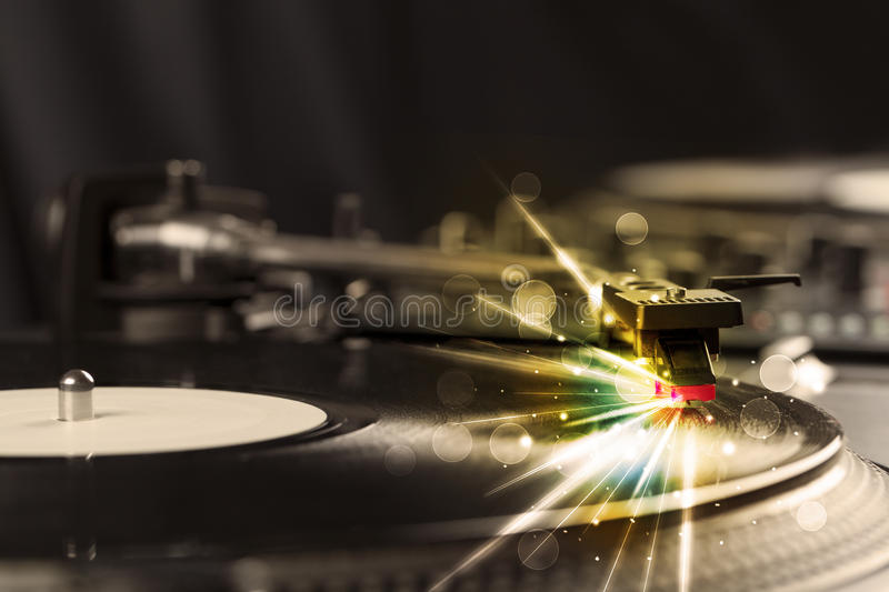 Music player playing vinyl with glow lines comming from the need royalty free stock photo