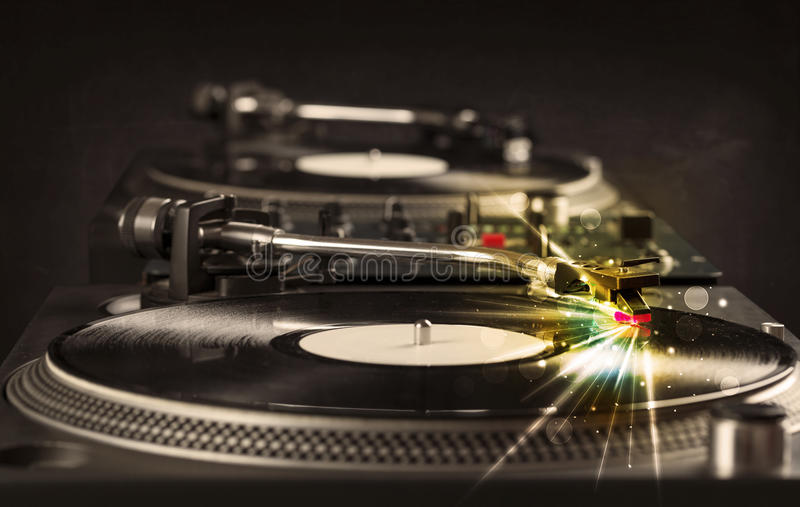 Music player playing vinyl with glow lines comming from the need stock photos