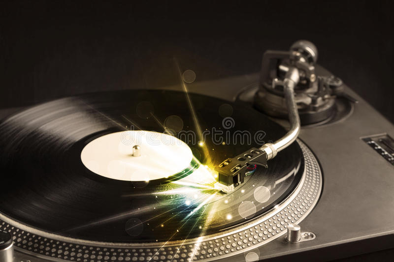 Music player playing vinyl with glow lines comming from the need stock image