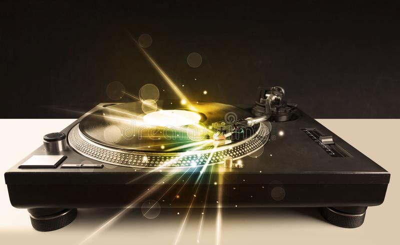 Music player playing vinyl with glow lines comming from the needle royalty free stock images