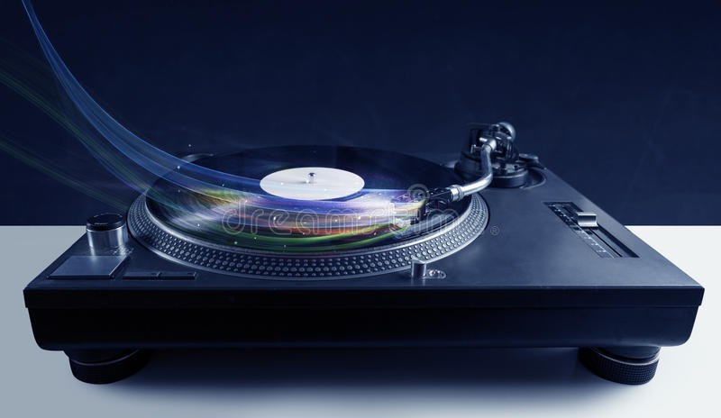 Music player playing vinyl music with colourful abstract lines stock photo