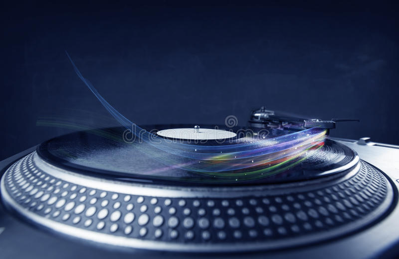 Music player playing vinyl music with colourful abstract lines royalty free stock images