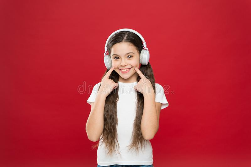 Music plays an important part lives teenagers. Powerful effect music teenagers their emotions, perception of world. Girl. Listen music headphones on red royalty free stock photos