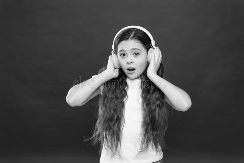 Music plays an important part lives teenagers. Powerful effect music teenagers their emotions, perception of world. Girl. Listen music headphones on red stock images