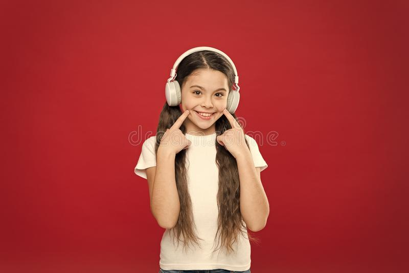 Music plays an important part lives teenagers. Powerful effect music teenagers their emotions, perception of world. Girl. Listen music headphones on red stock photos