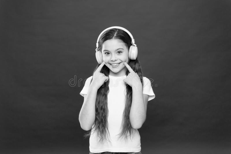 Music plays an important part lives teenagers. Powerful effect music teenagers their emotions, perception of world. Girl. Listen music headphones on red stock image