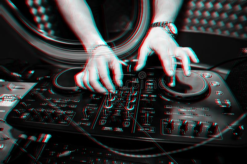 Music remote for information and mixing music in nightclub with DJ hands closeup. Music remote for information and mixing music in a nightclub with a DJ hands royalty free stock images