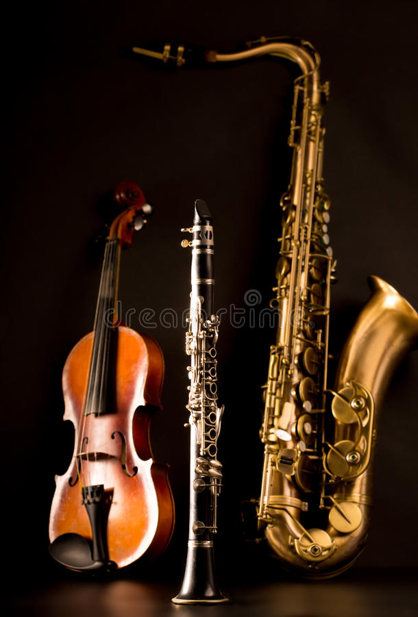 Music Sax tenor saxophone violin and clarinet in black. Background stock images