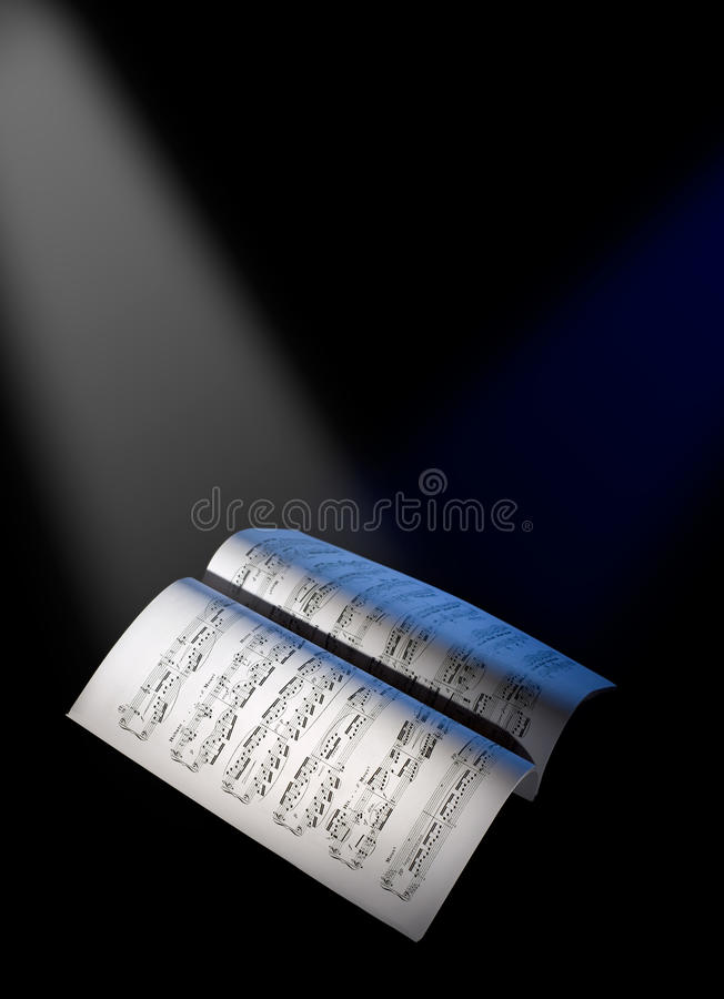 Free Music Sheets Under The Reflector Lights Royalty Free Stock Photography - 12194107