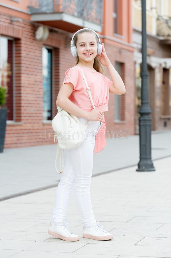 Music should be your escape. Adorable small child enjoy music playing in earphones. Little girl enjoying her favorite. Music. Cute kid listening to music stock images
