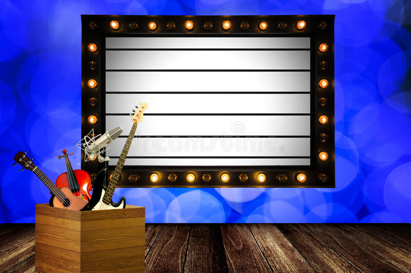 Music show concept. Instrument with info board stock image