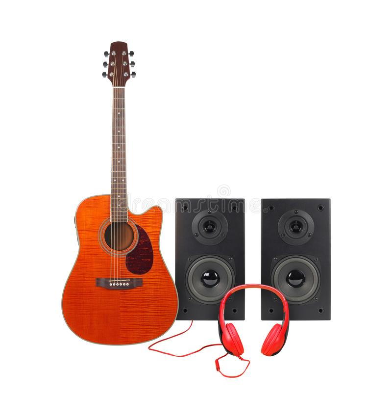 Music and sound - Orange electro acoustic guitar, two loudspeaker enclosure and red headphone. Isolated stock photography