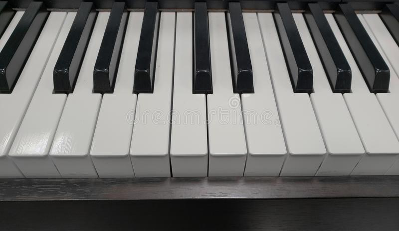 Approach to an electric piano, background and texture. Music and sound, melody and harmony, used in different styles and musical genres, composition and royalty free stock photos