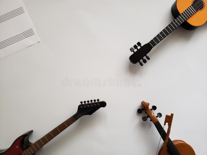 Background musical theme with string musical instruments and a sheet with lines for musical notes. Music and sound, melody and harmony, used in different styles stock photo