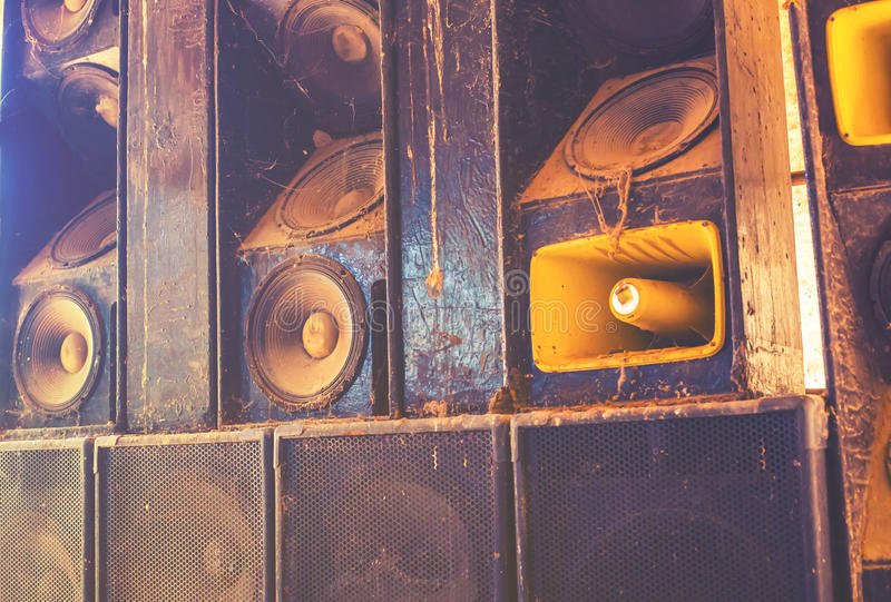 Music sound speakers hanging on the wall in monochrome vintage style.  stock image