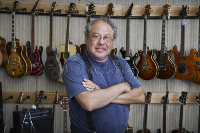 Music Store Owner Standing Arms Crossed stock images