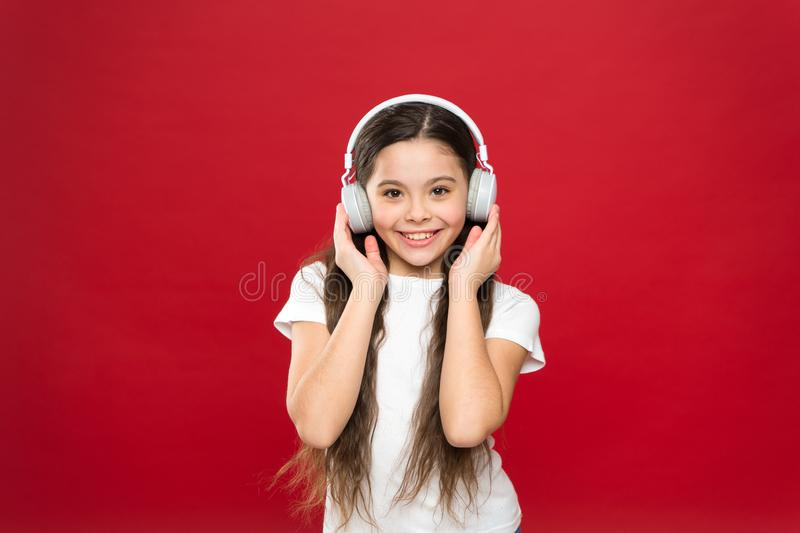 Music taste. Music plays an important part lives teenagers. Powerful effect music teenagers their emotions, perception. Of world. Girl listen music headphones royalty free stock photo