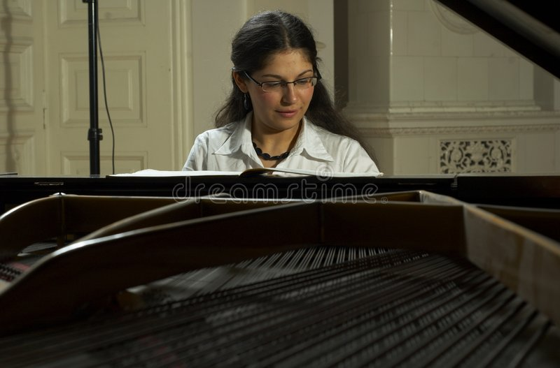 Download Music Teacher And Grand Piano Stock Photography - Image: 1721912
