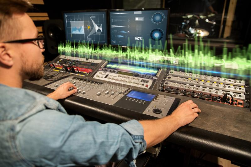 Man at mixing console in music recording studio stock image image download man at mixing console in music recording studio stock image image of equipment ccuart Choice Image