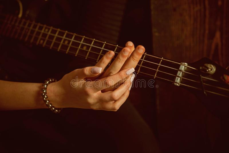 Music is their passion. Couple of guitar players. Couple in love play duets. Male and female hands play the electric. Guitar. Couple of musicians enjoy playing stock photography