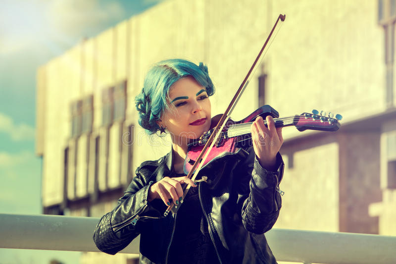 Music on violin by woman perform in park outdoor. royalty free stock images