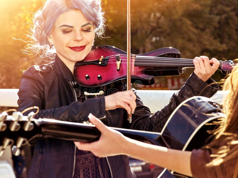 Music on violin by woman perform in park outdoor. royalty free stock image