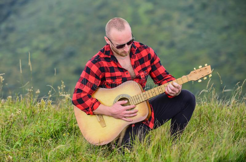 Music is what I am. country music song. sexy man with guitar in checkered shirt. hipster fashion. western camping and. Hiking. happy and free. cowboy man with royalty free stock photography