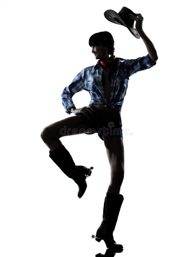 Musica country felice di dancing del danzatore della ragazza della mucca della donna fotografia stock