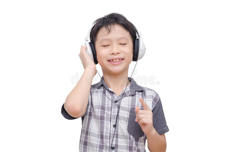 Musica d'ascolto del ragazzo dalla cuffia immagini stock