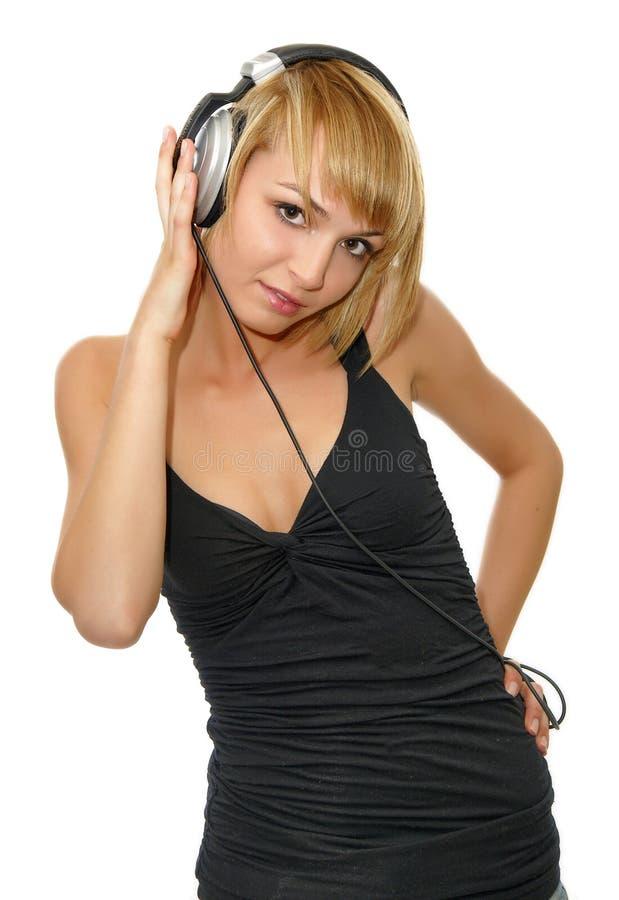 Musica d'ascolto della ragazza immagine stock