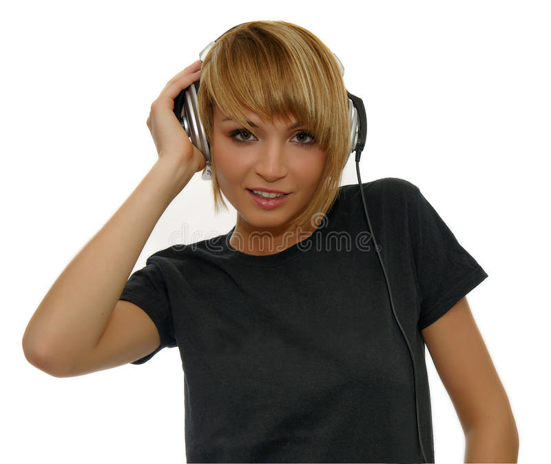 Musica d'ascolto della ragazza fotografia stock libera da diritti