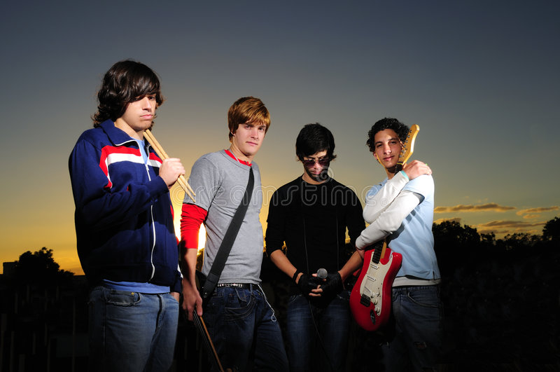 Musical band. Portrait of young trendy musicians group posing royalty free stock photography
