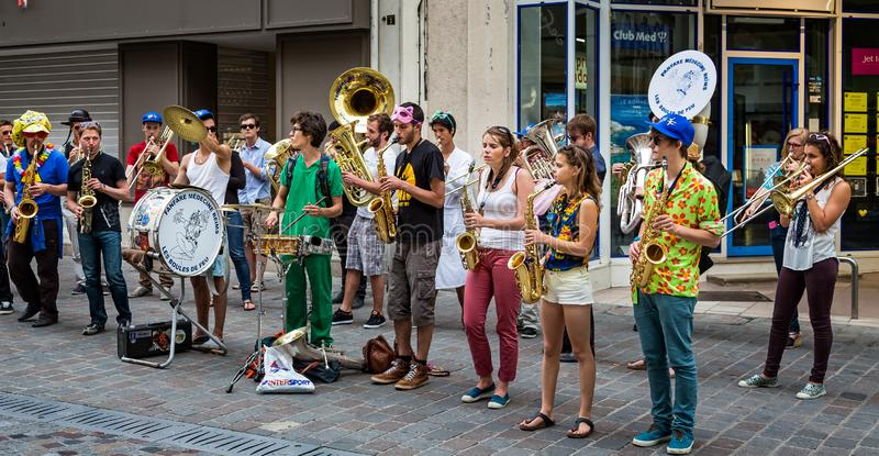 Musical band of medical students performing in the street stock images